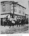 Marching band in a parade outside Renton Clothing Company honoring Frank Frenchy Vaise, Renton,...