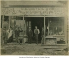 C. S. Custer General Store exterior showing men outside entrance, Renton, 1880