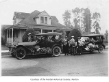 Garden Club members with bouquets and cars, Renton, n.d.