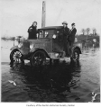McGarrigle family's car on a flooded roadway, Renton, 1926