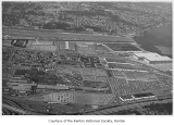 Boeing Airplane Company plant, Renton Airport, Renton High School Stadium and environs, aerial...