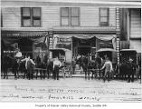 Men and delivery wagons outside Phalen's Grocery, Seattle, August 1908