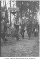 Boy Scouts marching through trees, Seattle, ca. 1934