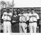 Alice Brougham with Seattle Rainiers players at Sick's Stadium, Seattle, 1943