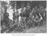 Boy Scouts eating near tent, Seattle, ca. 1934