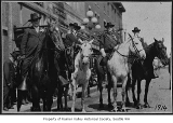 Buffalo Bill Cody with Civil War veterans in parade, Seattle, 1914