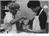 Two students cooking at Asa Mercer Junior High School, Seattle, ca. 1972