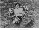 Frank Pritchard after a successful hunt, Seattle, ca. 1910