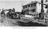 Machinery paving Hudson Street near 53rd, Seattle, June 13, 1949