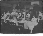 Franklin High School cooking class serving dinner to their parents, Seattle, 1910
