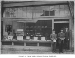 Three men in doorway of Rainier Valley Investment Company, Seattle, 1908