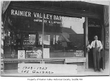 Lee Gardner in doorway of Rainier Valley Barber Shop, Seattle, 1917