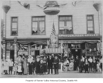 Crowd outside Phalen's Grocery during Rainier Valley Fiesta, Seattle, 1915