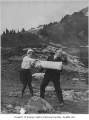 Marion and T.G. Hitt with firework made of snow near Mt. Rainier, 1928