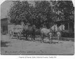 Fred Dudley driving G.S. Dudley & Sons fuel wagon, Columbia City, ca. 1895