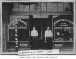 Menzo LaPorte and Lee Gardner in doorway of Rainier Valley Barber Shop, Seattle, 1910