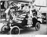 Hitt family in decorated car in front of bakery, Seattle, ca. 1913
