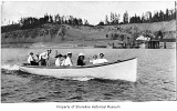 Motorized whaleboat with nine passengers near the coast at Richmond Beach, ca. 1910