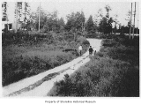 Ronald Store and dirt road near Interurban tracks, Ronald, 1925