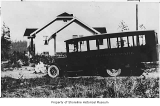 Emma, John and Bob Muller with school bus outside Muller home, Lake Forest Park, 1924