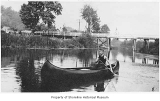 Canoeing through Sammamish Slough, near Kenmore, ca. 1915