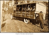 Motor Coach serving Edmonds, Richmond Beach and Seattle, in mud, probably somewhere in Shoreline, ...