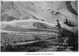 Richmond Beach Sand & Gravel Company bunkers showing a worker sluicing sand, Richmond Beach,...