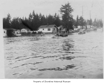 Flood on Aurora Avenue North showing cars driving through water, Richmond Highlands, ca. 1948
