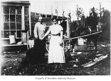 Earl and Marion Rogers outside Rogers General Store with their delivery wagon, Richmond Highlands,...