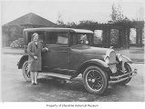 Beryl Watson next to a Whippet sedan at Volunteer Park, Seattle, 1927