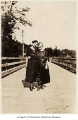 Hannah Smith and Emma Caskey on a bridge at Richmond Beach, ca. 1920