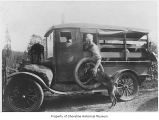 Will Taylor in a truck with Tony the goat on the hood and Freida the dog near the running board,...