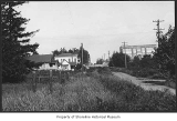 Brick school and houses on a dirt road in Richmond Beach, 1924