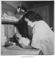 Hospital worker with newborn baby, Minidoka, ca. 1943