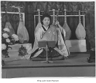 Namiko Nakagawa playing the biwa, Minidoka, ca. 1943