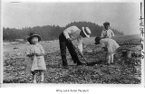 Family digging for clams on Puget Sound, June 8, 1925