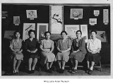 Mrs. Fukuda's embroidery class with their work, Minidoka, ca. 1943