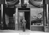 Lun Poy Woo in front of Quong Tuck Co., Seattle, ca. 1920