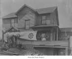 Konkodo Shinto Shrine building with flags and banners, Seattle, ca. 1910