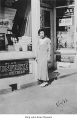 Iku Arizumi in front of Arizumi Drugstore, Seattle, August 10, 1933