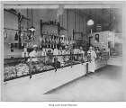 Butchers behind counter at Russell's Meat Market, Seattle, n.d.
