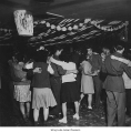 Couples dancing in decorated room, Minidoka, ca. 1943