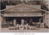 Ford's Market with May Heisserman and Clara and Ford Sinex standing outside entrance, Auburn, ca....