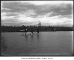 Flood in O'Brien with men on a raft, ca. 1910