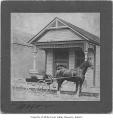 B.E. Hoye's office, exterior, with horse and buggy outside entrance, Auburn, ca. 1900