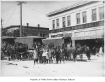 Horse drawn school buses in downtown Kent, 1915