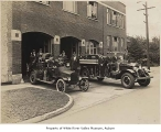 Auburn Fire Department, exterior, with firefighters on trucks,  Auburn, 1920