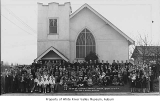 Messiah Lutheran Church, exterior, with people posing in front, Auburn, 1944