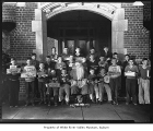 Briscoe Boys School at Christmas, with students outside entrance, Orillia, 1934