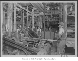 Covington Mill, interior, showing workers and some machinery, Kent, ca. 1920